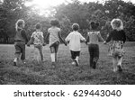 group of diverse kids playing... | Shutterstock . vector #629443040