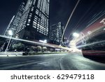 traffic through the modern city | Shutterstock . vector #629479118