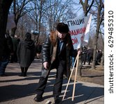 Small photo of LUGANSK / LUHANSK, UKRAINE - APRIL 5, 2014: pro-Russian activist at the rally, holding a banner in his hands.