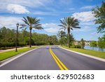 road with palm trees   Shutterstock . vector #629502683
