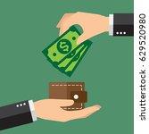hands holding dollar bills and... | Shutterstock .eps vector #629520980