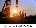 the oil workers at work | Shutterstock . vector #629565344