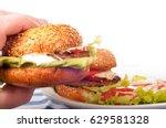 hand holds fresh hamburger.... | Shutterstock . vector #629581328