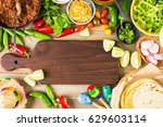 ground beef tacos with romaine... | Shutterstock . vector #629603114