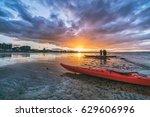 Kayaks And Kayakers On Beach At ...
