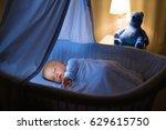 adorable baby drinking milk in... | Shutterstock . vector #629615750