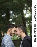 Small photo of Gay Couple Love Outdoors Concept