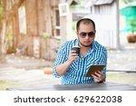 man holding smart tablet....   Shutterstock . vector #629622038