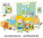 little boy playing with bricks... | Shutterstock .eps vector #629663630