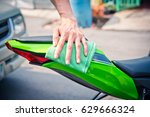 hand with man cleaning... | Shutterstock . vector #629666324