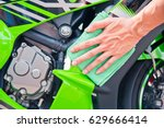 hand with man cleaning... | Shutterstock . vector #629666414
