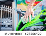 hand with man cleaning... | Shutterstock . vector #629666420