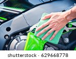 hand with man cleaning... | Shutterstock . vector #629668778