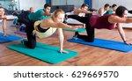 smiling adults having yoga... | Shutterstock . vector #629669570