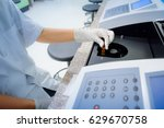 Small photo of Scientist working at the laboratory with Spectrophotometer, cholesterol test lab and optical density determine
