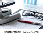 doctors desk with microscope... | Shutterstock . vector #629673398