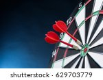 Dartboard On A Blue Background...