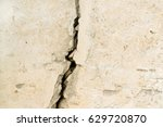 concrete with a  big crack | Shutterstock . vector #629720870