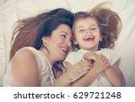 young mother playing with her... | Shutterstock . vector #629721248