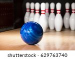 skittles and bowling ball on... | Shutterstock . vector #629763740