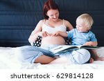pregnant mother and son are... | Shutterstock . vector #629814128