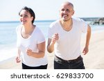 smiling adult couple in white t ... | Shutterstock . vector #629833700