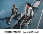 smiling young sportswomen with... | Shutterstock . vector #629835860