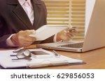 business woman hands holding... | Shutterstock . vector #629856053