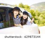 happy asian children sticking... | Shutterstock . vector #629873144