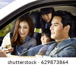happy asian family with two... | Shutterstock . vector #629873864
