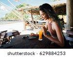 girl drinks juice and checks...   Shutterstock . vector #629884253