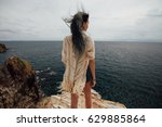 Young Woman Standing On Cliff'...