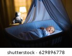 adorable baby in blue bassinet... | Shutterstock . vector #629896778
