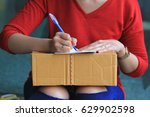 woman signing receipt of... | Shutterstock . vector #629902598