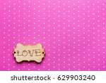 Wooden Tag With Word Love On...