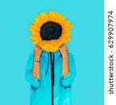 sunflower girl surreal minimal... | Shutterstock . vector #629907974