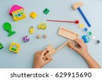 child collects and paints a... | Shutterstock . vector #629915690