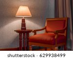 red chair with desk lamp in... | Shutterstock . vector #629938499
