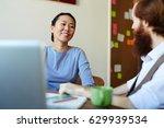 happy young designer listening... | Shutterstock . vector #629939534