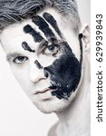 young man with black hand print ... | Shutterstock . vector #629939843