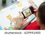 schoolgirl photographing her... | Shutterstock . vector #629941400