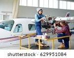 airplane service crew repairing ... | Shutterstock . vector #629951084