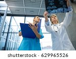 female doctor and nurse... | Shutterstock . vector #629965526
