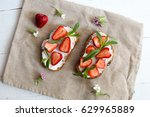 two toasts or bruschetta with... | Shutterstock . vector #629965889