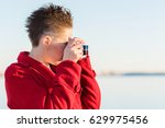 girl is taking pictures near... | Shutterstock . vector #629975456