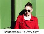 girl in red posing on green... | Shutterstock . vector #629975594