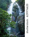 Small photo of A small water fall in a national park in thailand. 1-2 sec exposure.