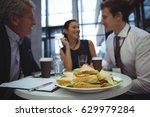 businesspeople interacting... | Shutterstock . vector #629979284