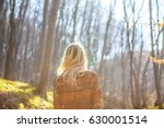 blonde girl in the forest.... | Shutterstock . vector #630001514