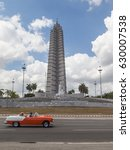 Small photo of HAVANA, CUBA - APR 17, 2017: Jose Marti Memorial at Revolution Square, Havana, Cuba with blurry classic red car passing. Jose Marti Memorial is a memorial to Jose Marti, a national hero of Cuba.